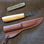 Hand-forged Viking Age knife, sheath, and whetstone.